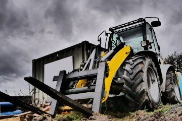 "featured image of the blog titled ""The Ultimate Guide To Buying a Rough Terrain Forklift in Denver"""