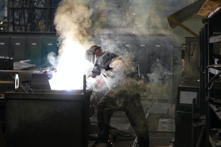 Man welding stainless steel