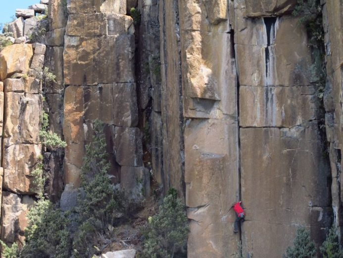 Rock climbers on the dolerite columns of the Lost World, Mount Wellington