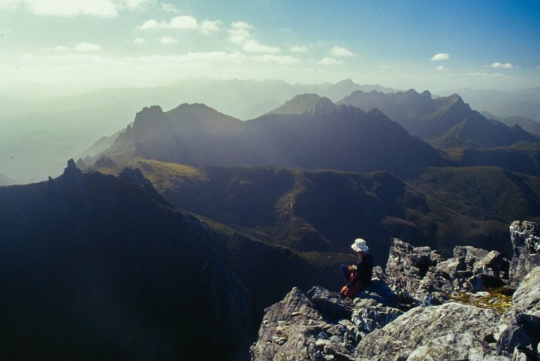 Rick Monty looking along the Eastern Arthurs from Federation Peak - by Angus Munro