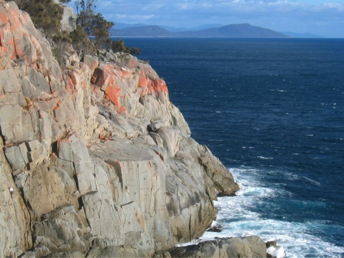 Climbers on White Water Wall, Freycinet - by Angus Munro