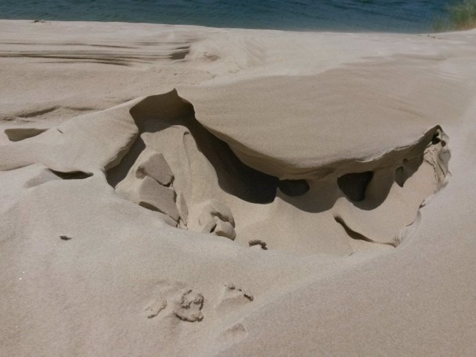 A collapsed artwork at the sand dune crest - At Five Mile Beach