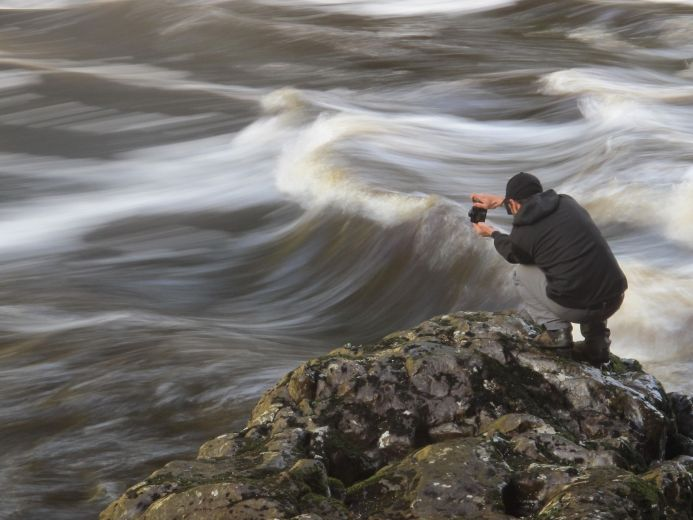 A expedition member tries to capture the everchanging waters
