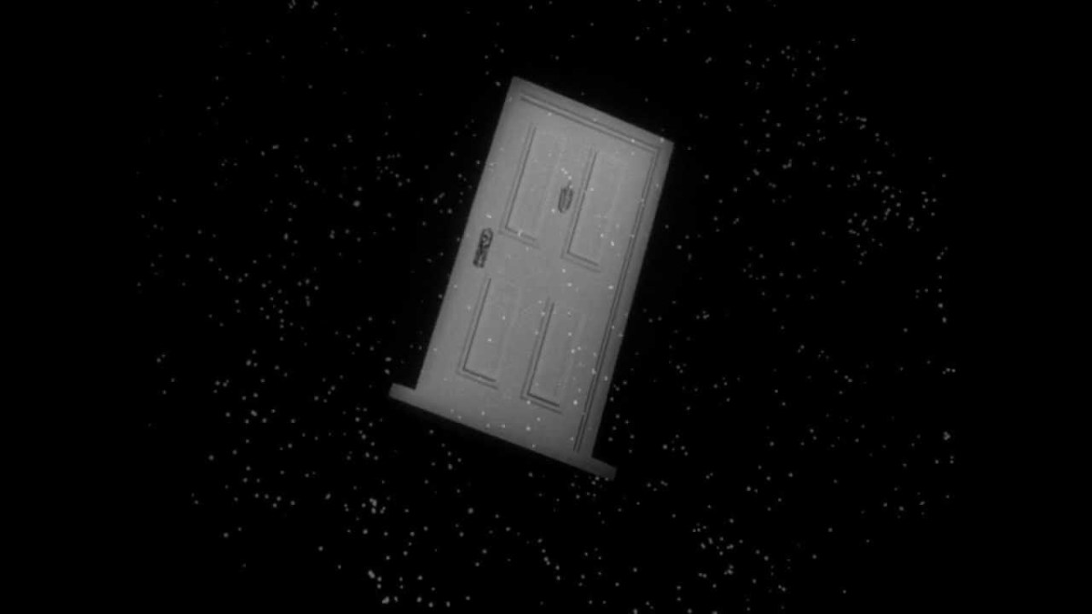 A door floating through space in the opening sequence.