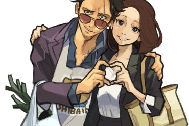 House husband and wife making hand heart gesture