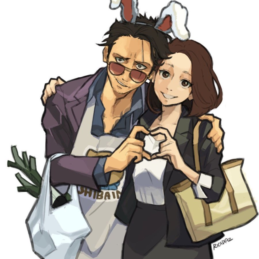House husband and wife making hand heart gesture