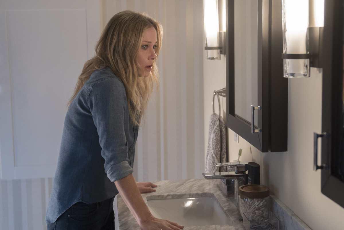 Jen in the bathroom in Dead To Me.