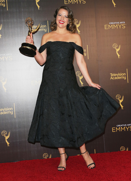 Kathryn Burns holding an Emmy award.