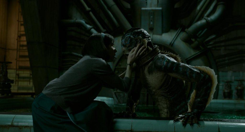 Eliza sweetly touching the face of the Amphibian Man.