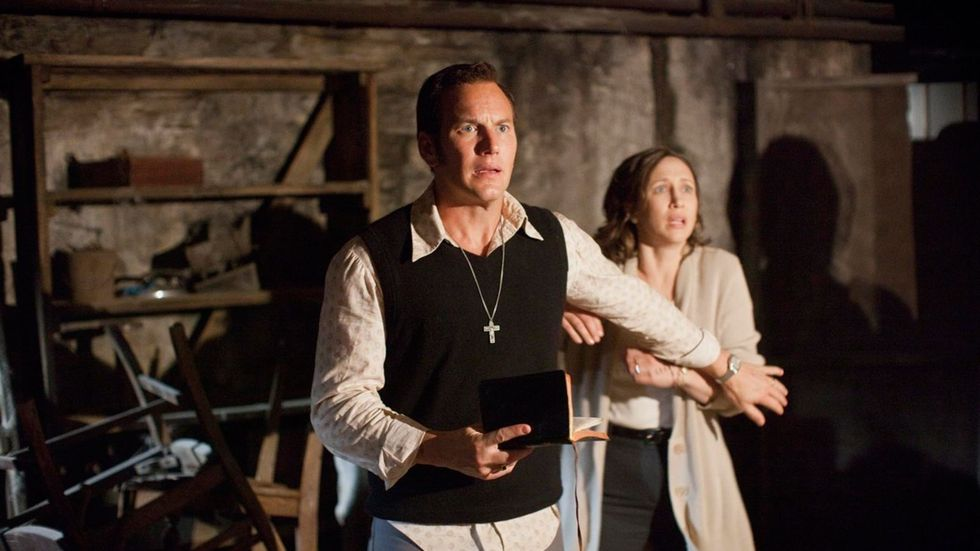 Ed and Lorraine Warren look horrified in the exorcism scene of The Conjuring