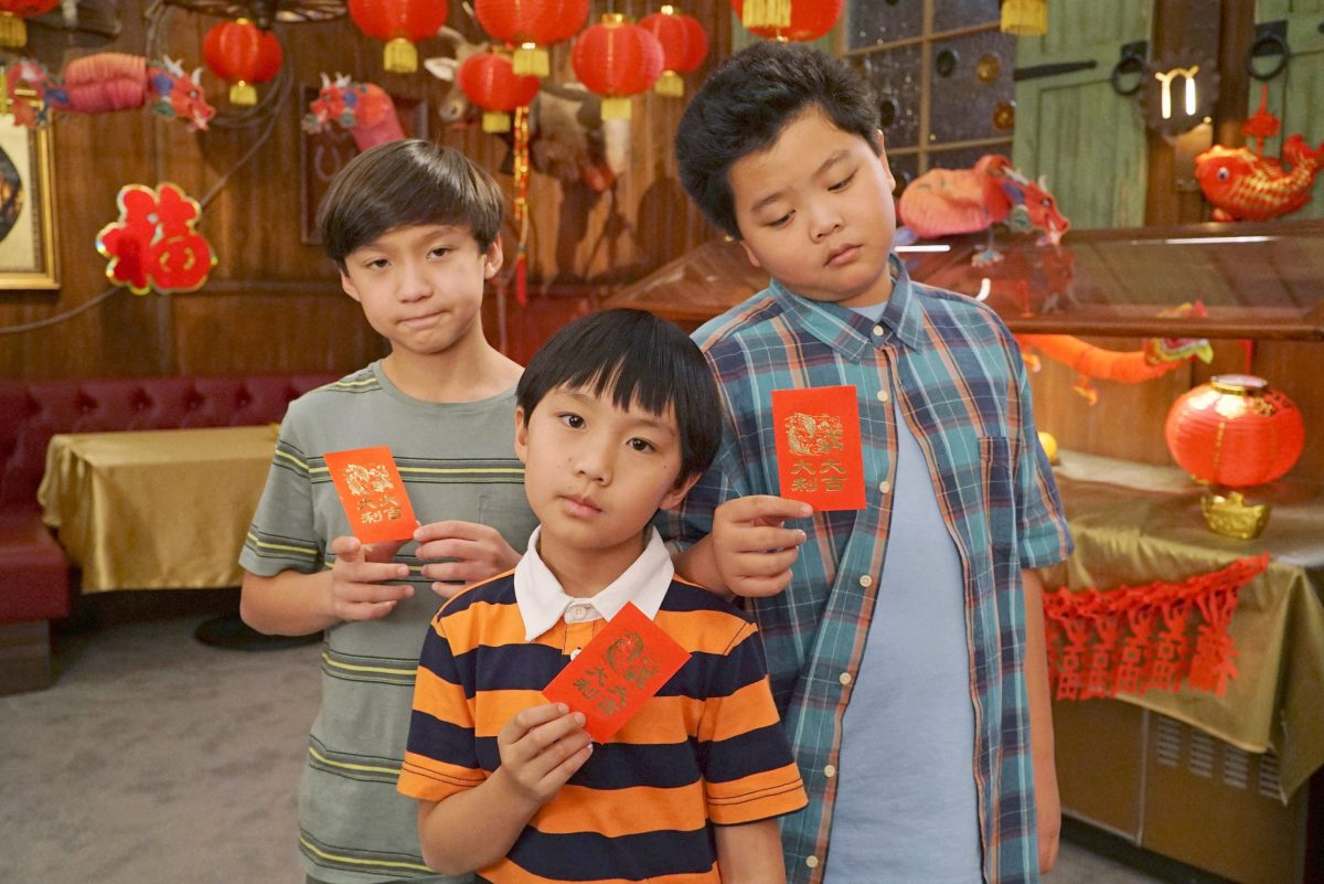 Holiday: The Huang brothers, in celebration of Chinese New Year, are holding traditional red envelopes.