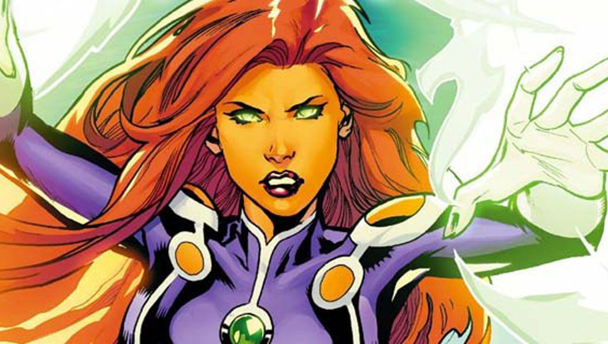 Starfire with her hands lite up ready for battle.