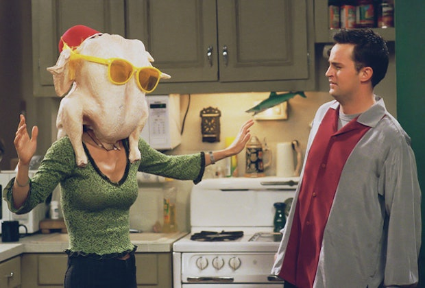 Joey gave Monica a look of disgust as she showed off the turkey wedged onto her head.