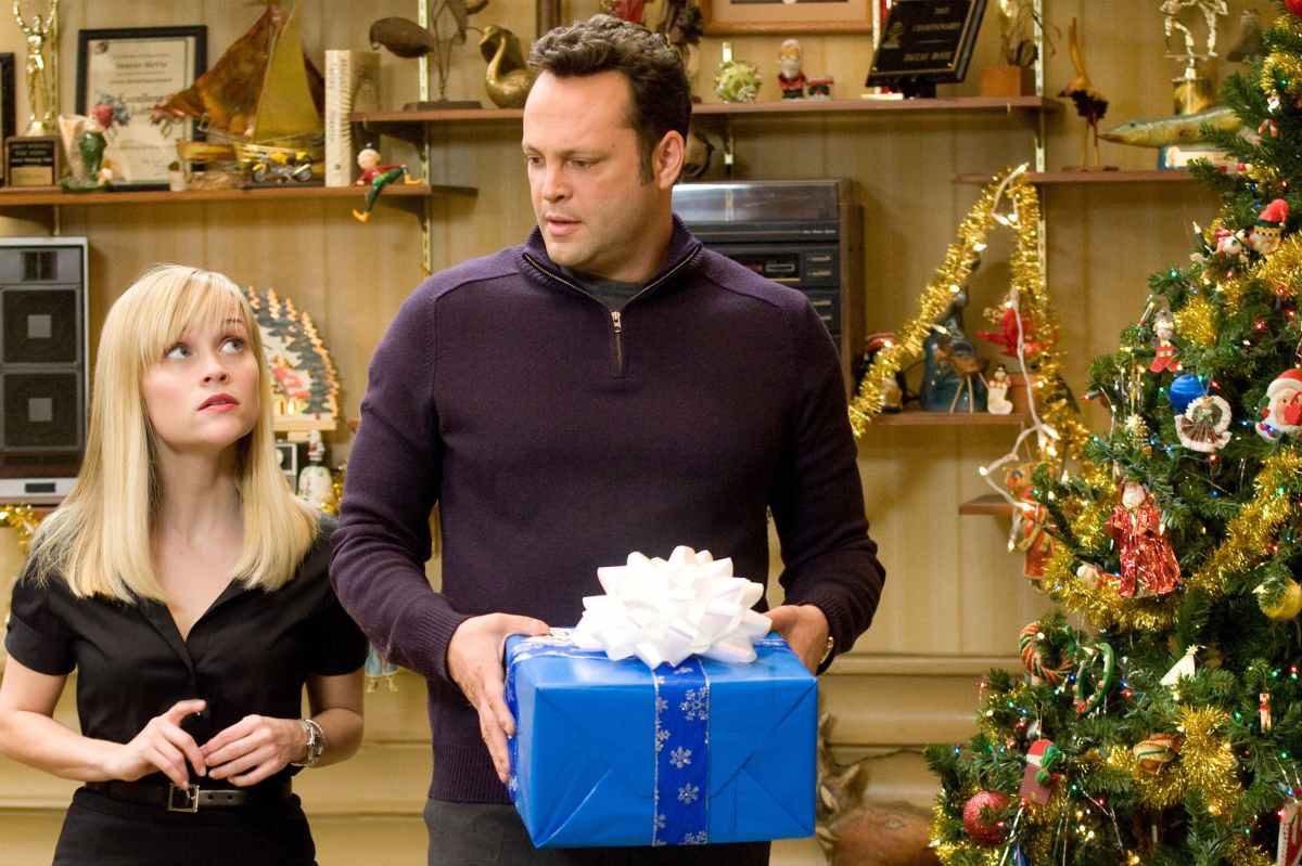 Brad holding a gift looking frustrated while Kate looks confused towards Brad.
