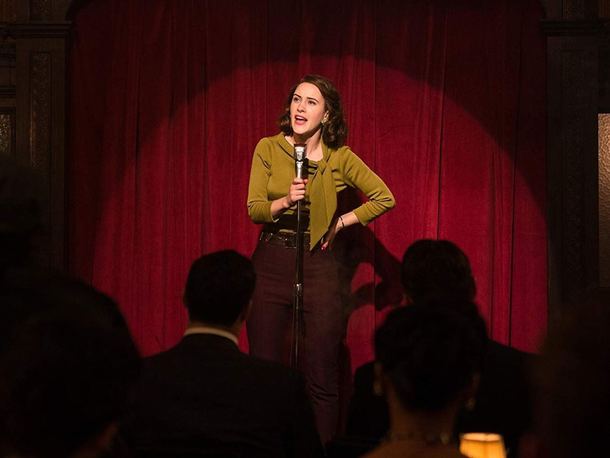 Miriam on stage performing stand up in the Amazon Prime show Marvelous Mrs. Maisel.