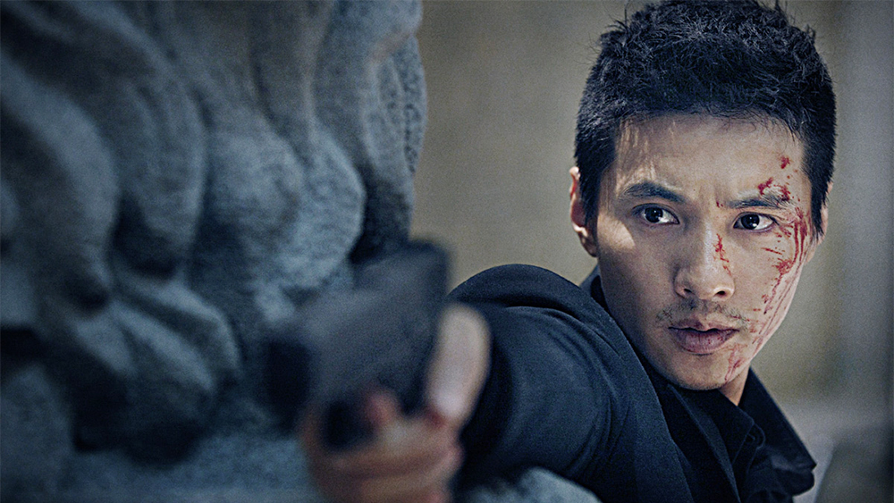 """Cha Tae Sik, from the Korean film """"The Man From Nowhere,"""" aims a pistol."""