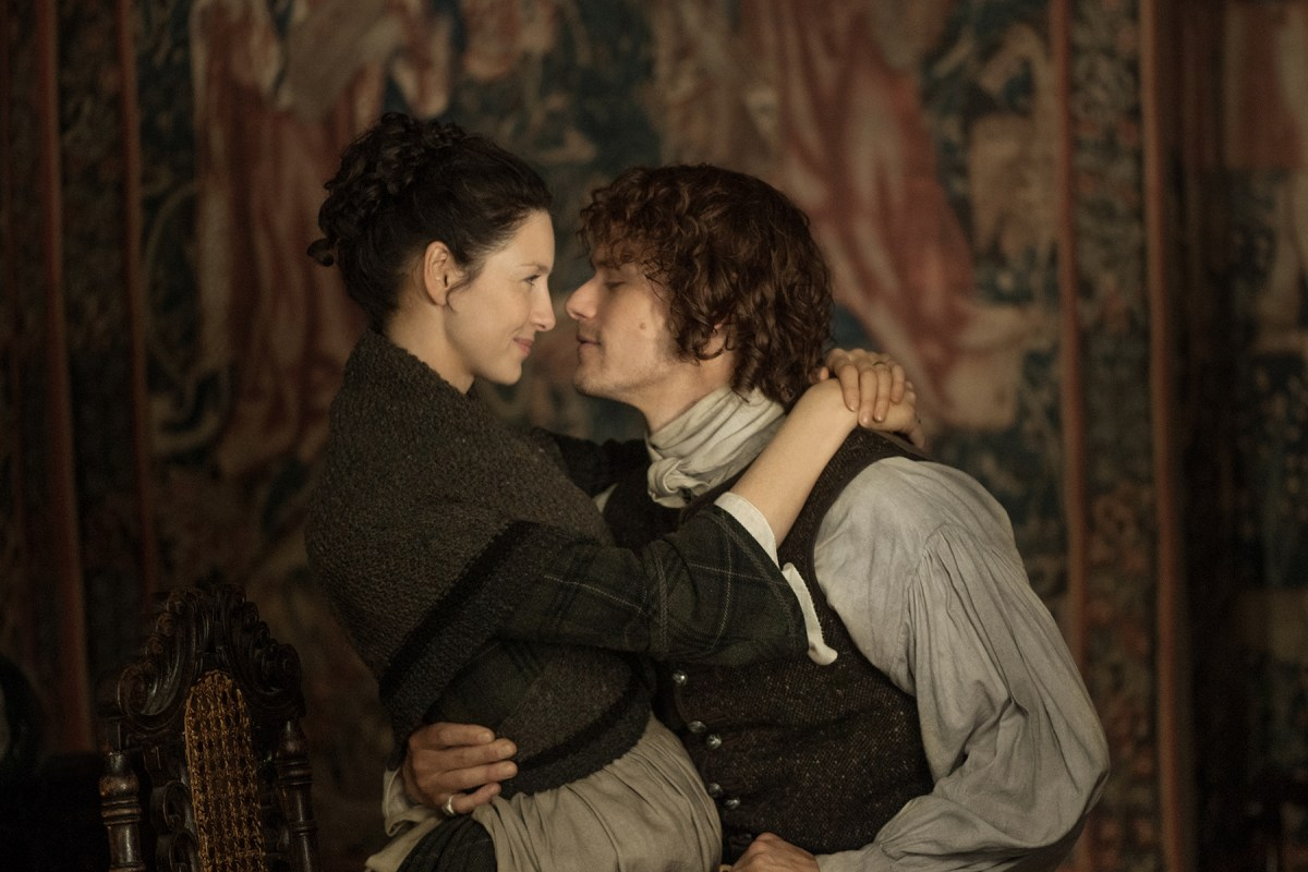 Claire and Jamie, the lead characters of Starz show Outlander looking intently at each other.