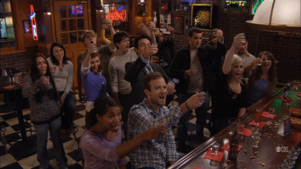 Everyone playing the drinking game 'But Um' at a college bar while watching Robin's morning show.