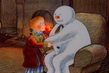 The snowman and boy in a chair. From The Snowman (1982).