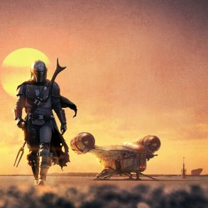 The Mandalorian walking forward with his ship behind him