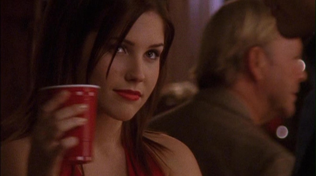 Fifth fictional role model, Brooke Davis, holding a red solo cup at a high school party.