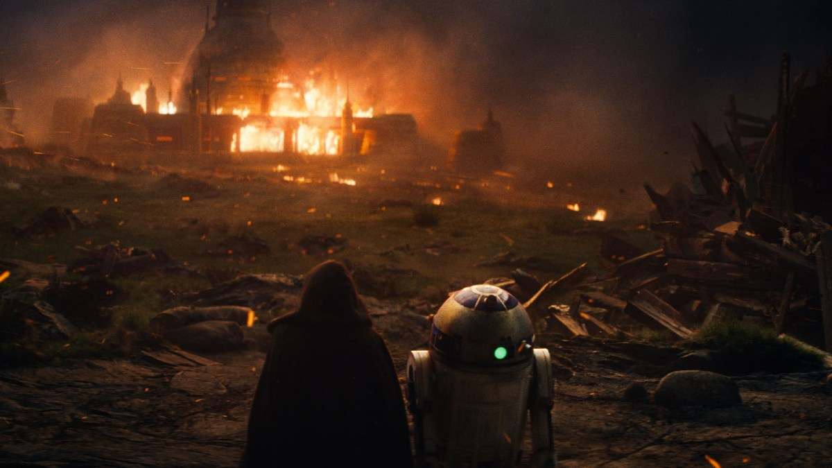 Luke sits amidst the wreckage of his burned Jedi Templre.