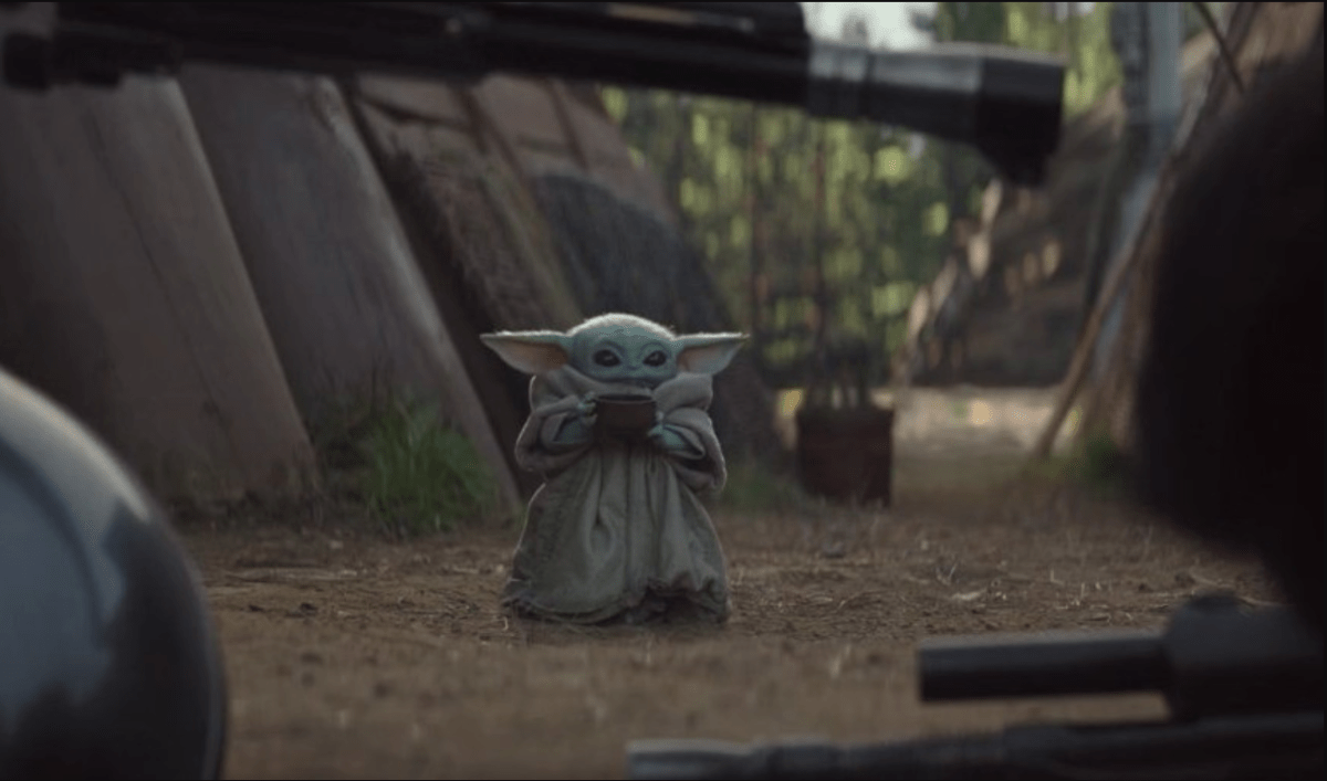 Baby Yoda sipping bone broth from a cup.