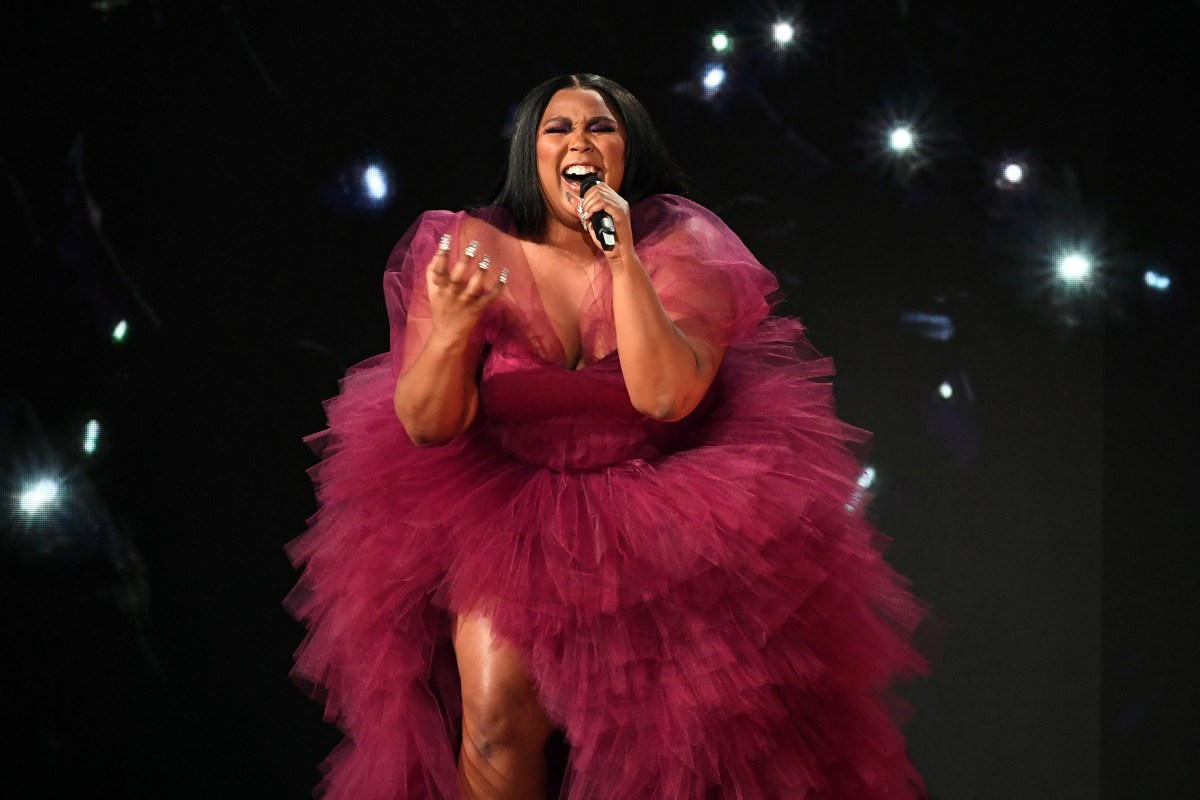 Performing at the AMA's in a magenta, ruffled dress.