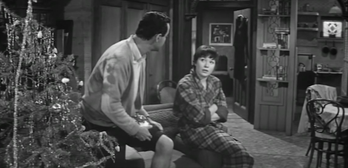 Jack Lemmon and Shirley Maclaine sit in an apartment near a Christmas tree in this non-traditional Christmas movie.