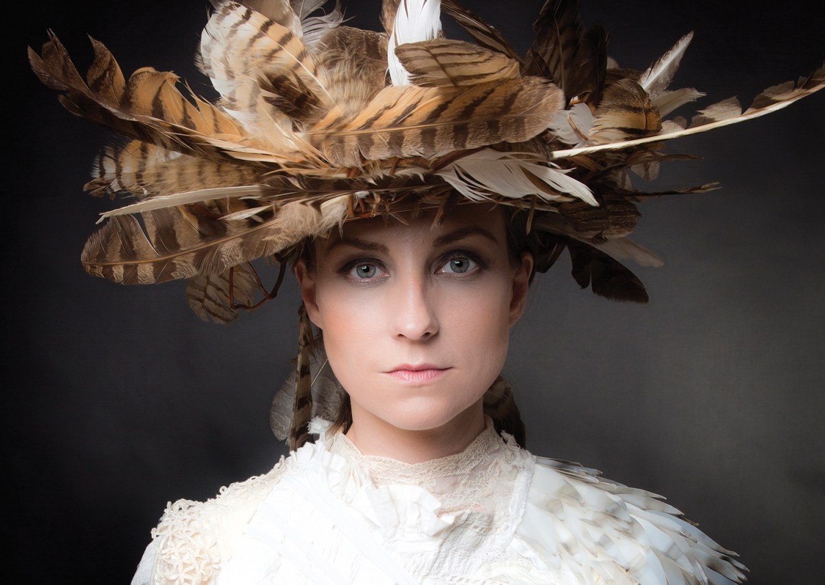 Julie Fowlis featured in a feather hat on the cover of her album Alterum.