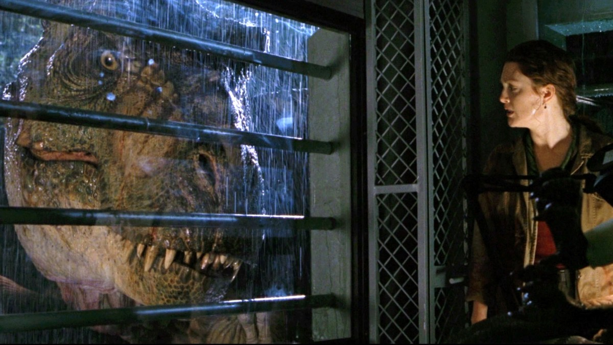 Dr. Sarah Harding watching a T-Rex outside of their camper window.