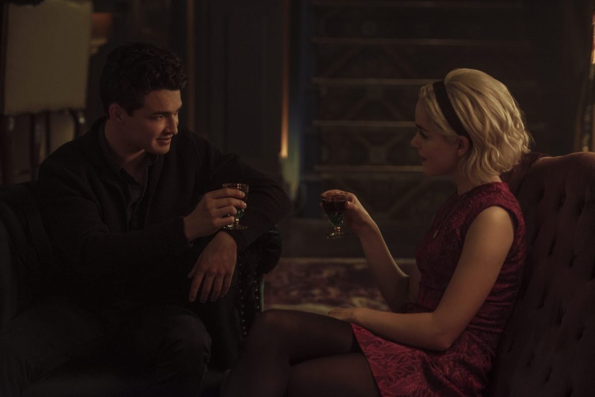 Sabrina Spellman and Nick Scratch making a toast to the future.