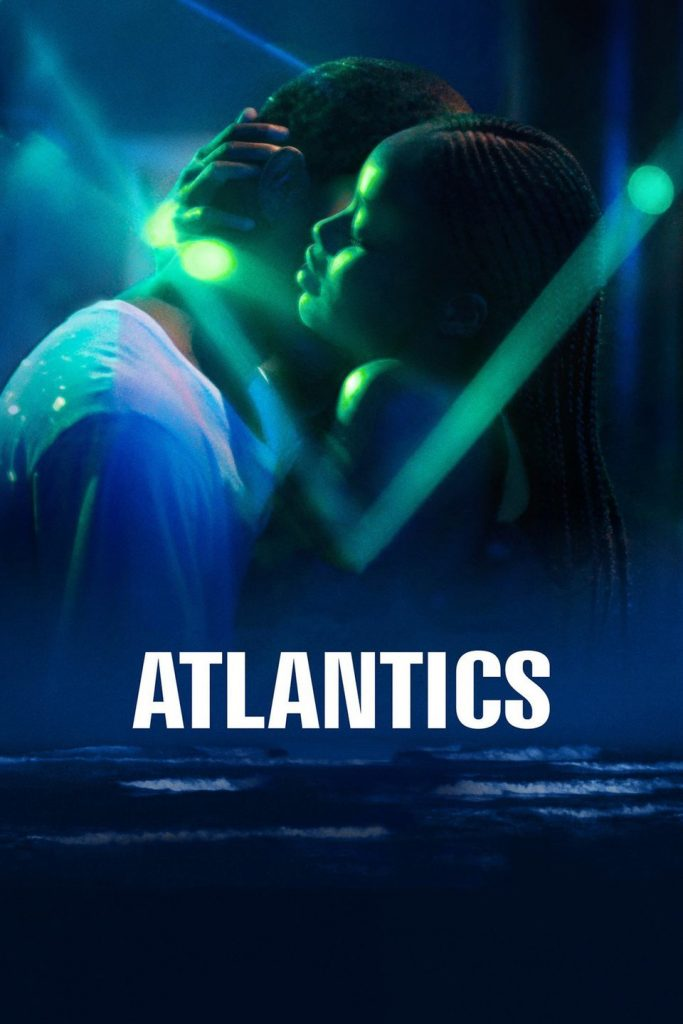 "Directors: The two protagonists of Atlantics embrace on a dark dance floor with the title ""Atlantics"" in block letters over the top."
