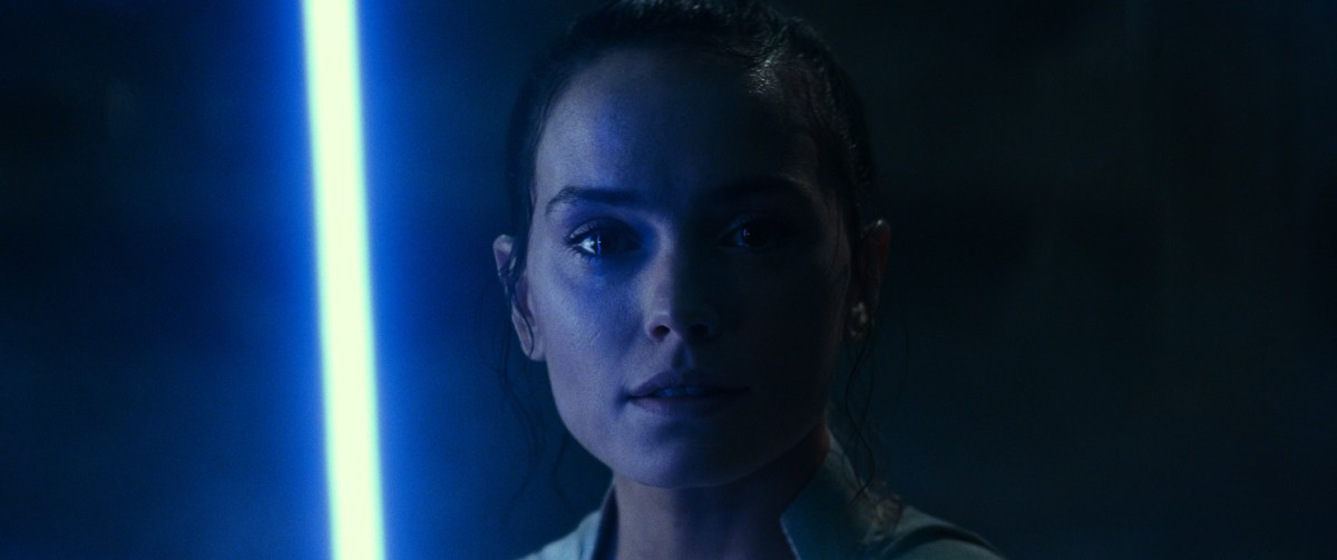 Rey crying in the midst of blue lighting.