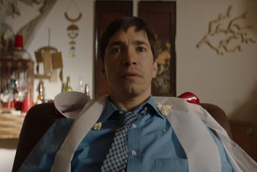 Frank (Justin Long) in the Wave stares blankly forward in the opening scene of The Wave