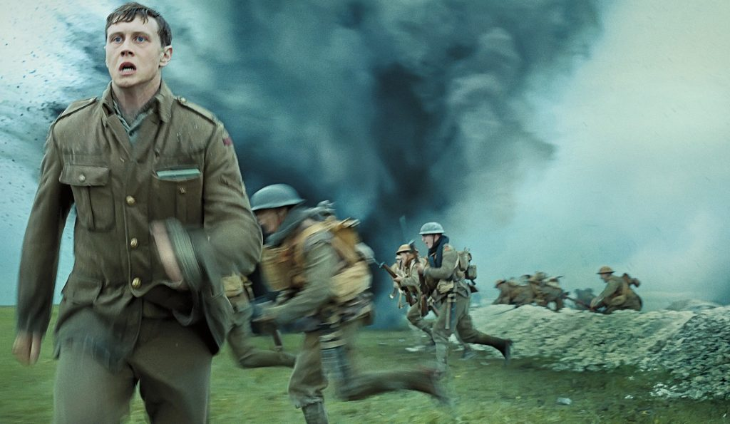George MacKay runs during a battle in 1917, a film overlooked by the Oscars for editing.