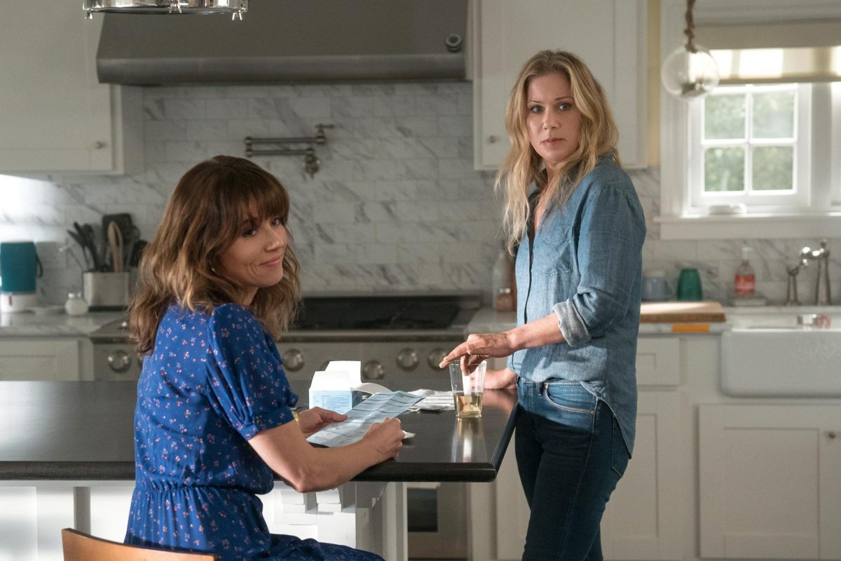 Christina Applegate and Linda Cardellini hanging out in a kitchen in the 2019 TV show Dead to Me.