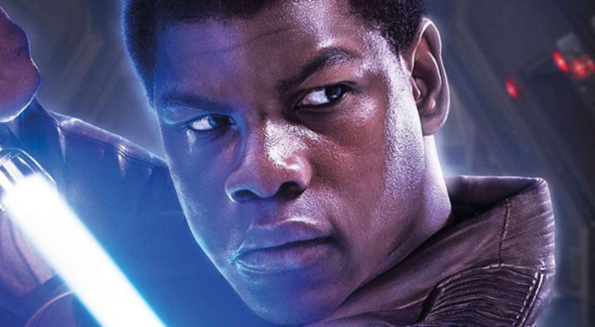 Finn brandishes a blue lightsaber