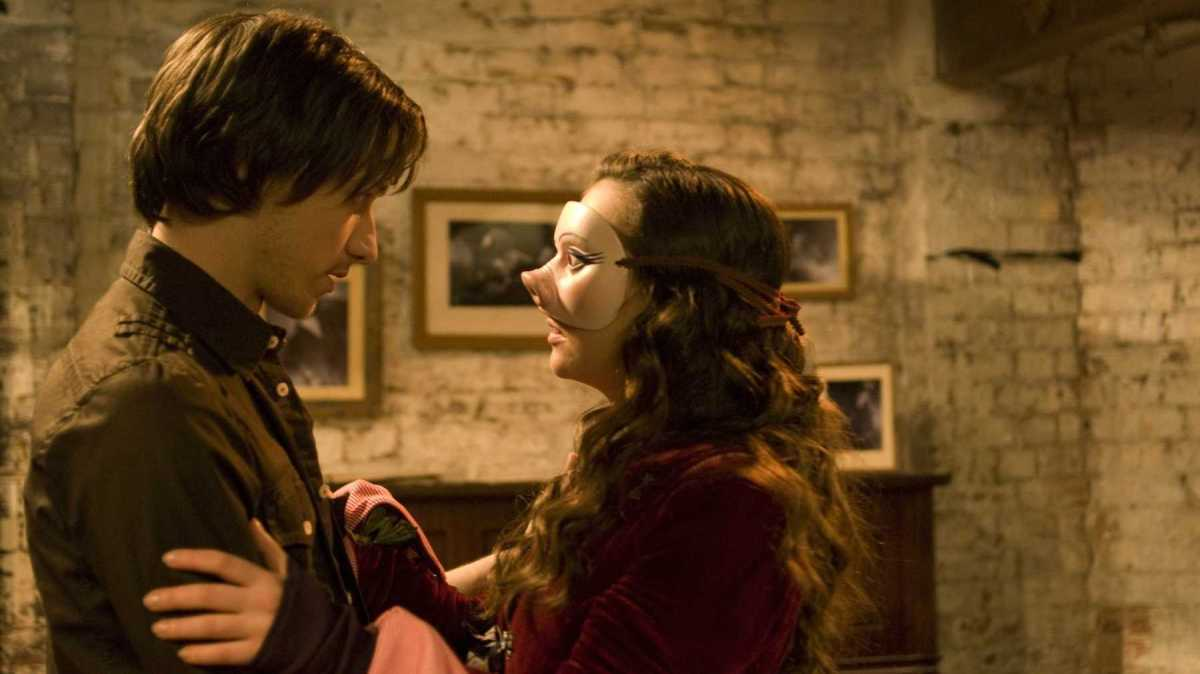Movies To Inspire: Max and Penelope reunite. It is Halloween and she is wearing a mask of her face with the pig nose to hide that she no longer has it.
