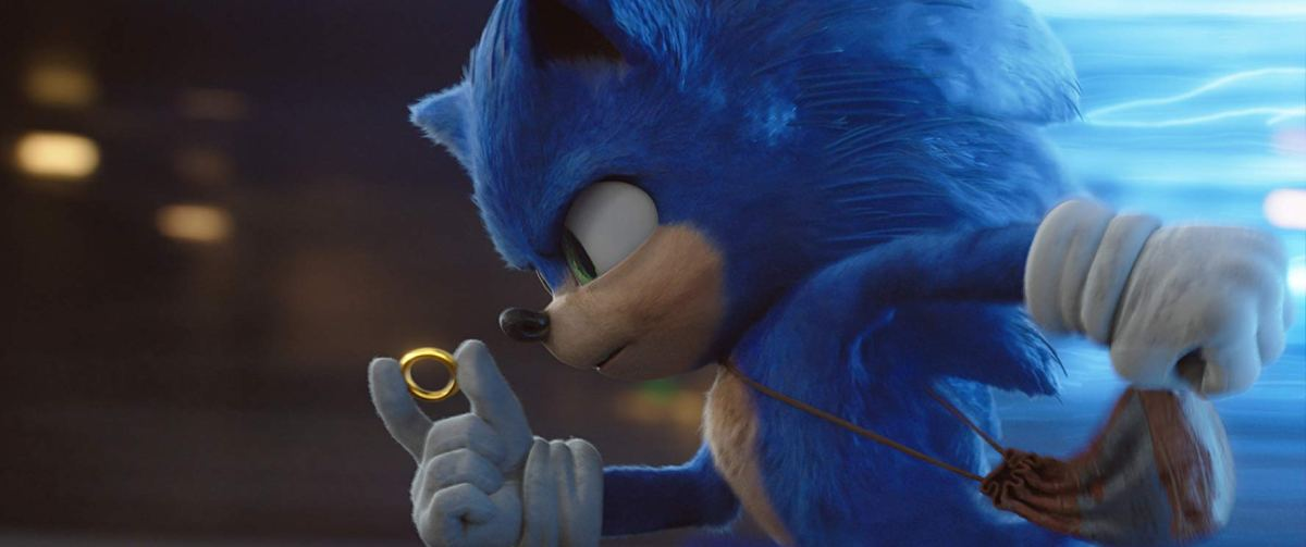 Sonic The Hedgehog holds a gold ring in the movie coming out Valentine's Day 2020.