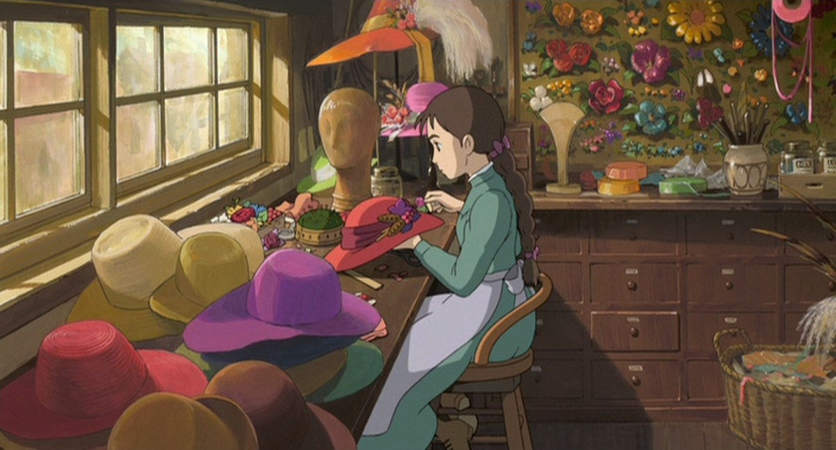 Movies To Inspire: A young Sophie sits sewing an elaborate hat.