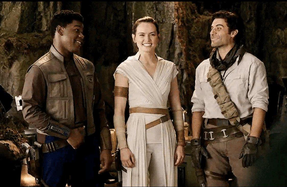 Behind the scenes shot of John Boyega, Daisy Ridley, and Oscar Isaac