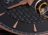 The complex guilloche keeps the entire surface of the dial on a complex composure