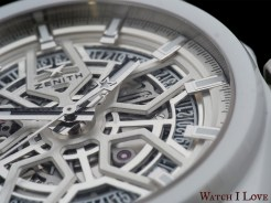 The white ceramic case is accompanied by with dial accents