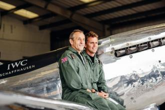 """GOODWOOD, WEST SUSSEX, ENGLAND - AUGUST 5: Pilots Steve Boultbee Brooks and Matt Jones attending the celebration of the official start of the """"Silver Spitfire - The Longest Flight"""" expedition in Goodwood. To the roaring applause of more than 400 guests, the carefully restored and polished Spitfire aircraft embarked on its unprecedented flight around the world (Photo by Remy Steiner/Getty Images for IWC)."""