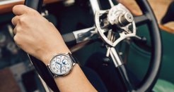 """A passion for classics: the 1815 ANNUAL CALENDAR on the wrist of Katie Forrest. During last year's Concours of Elegance, she won the RAC Spirit of Motoring Award for her 1912 Rolls-Royce Silver Ghost, """"Nellie""""."""