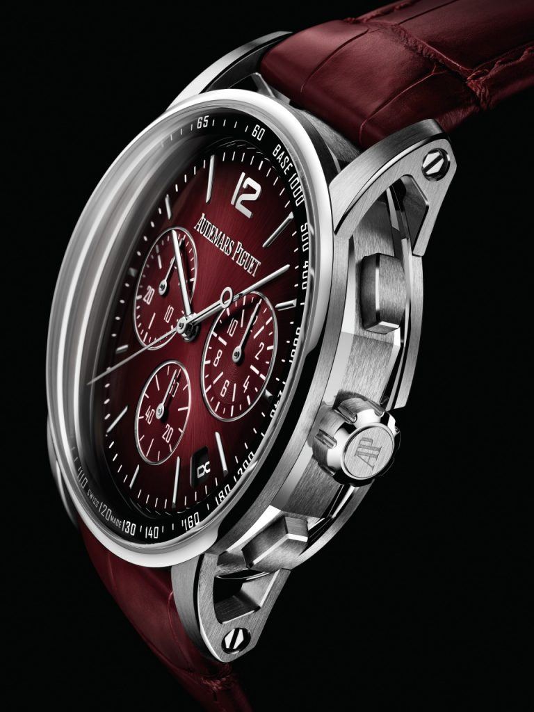 The smoked burgundy lacquered dial provides a powerful contrast with the white gold case of this Selfwinding Chronograph model.