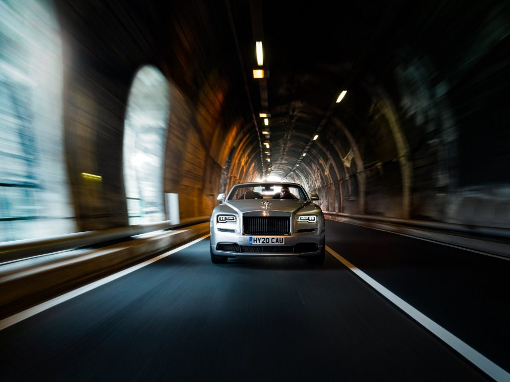 Rolls-Royce today releases the first official images showing Dawn Silver Bullet in its natural habitat – on the open road, as the first of the client commissioned Collection Cars roll off the production line at the Global Centre of Luxury Manufacturing Excellence, in Goodwood, West Sussex.  Photographed on the shores of Lake Garda, a series of in-motion and drone shots capture Dawn Silver Bullet in locations including mountain hairpins and corniche roads. The new photographic portfolio also includes static images, taken in the open air, highlighting the car's charismatic expression.  Under the Italian sun, Dawn Silver Bullet lives up to its name, travelling with speed and precision. Its ultra-metallic Brewster Silver Paint is a vibrant nod to the epic trials cars of the past, such as the Silver Dawn, Silver King, Silver Silence and Silver Spectre.  The four-seat Rolls-Royce Drophead is transformed into an adaptable two-seat roadster, by the addition of a rakish Aero Cowling with vapour-blasted titanium finisher, heightening the Collection's sense of speed and purpose.  Launched in 2020, Dawn Silver Bullet is a contemporary interpretation of the classic roadster spirit and driving experience, offering committed drivers a sublime blend of serenity and sophistication with an exhilarating sense of uncompromised freedom.  Dawn Silver Bullet is strictly limited to just 50 examples worldwide.
