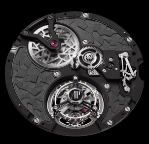 Inspired by the suit of Marvel's Black Panther, Calibre 2965's uneven geometric titanium bridges adorned with grey and black PVD coating reveal the flying tourbillon cage at 6 o'clock and the openworked barrel at 10 o'clock, on the dial side.