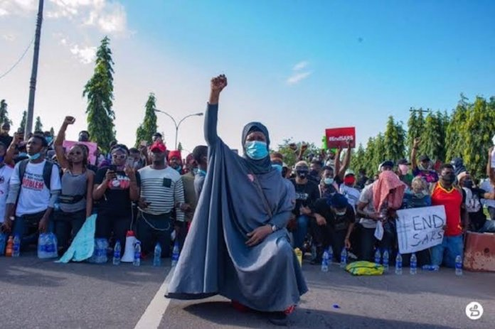 ee9db394 when humanity showed up at endsars ... protesters led by aisha yesufu taking a knee during the protests in abuja
